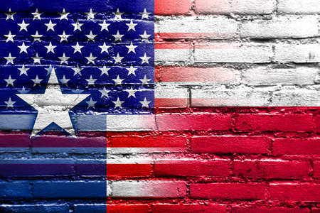 USA and Texas State Flag painted on brick wall photo