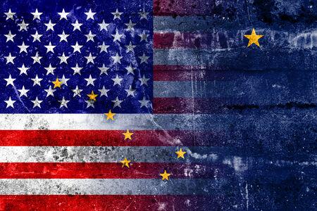 USA and Alaska State Flag painted on grunge wall