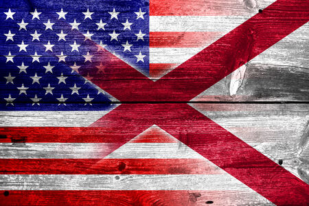 alabama state: USA and Alabama State Flag painted on old wood plank texture