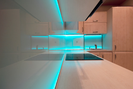 Modern luxury kitchen with blue LED lighting photo