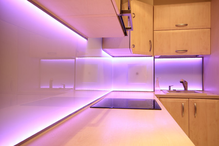 Modern luxury kitchen with pink LED lighting photo