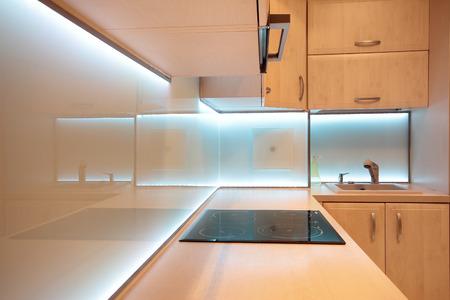 Modern luxury kitchen with white LED lighting