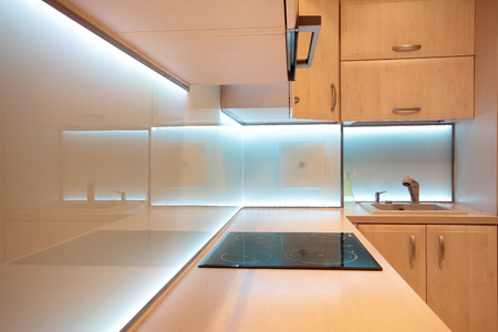 Modern luxury kitchen with white LED lighting photo