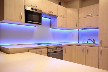 light house: Modern luxury kitchen with purple LED lighting