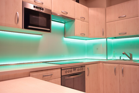 architectural lighting design: Modern luxury kitchen with green LED lighting