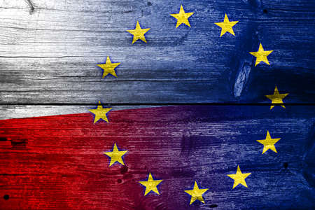 Poland and European Union Flag painted on old wood plank texture photo