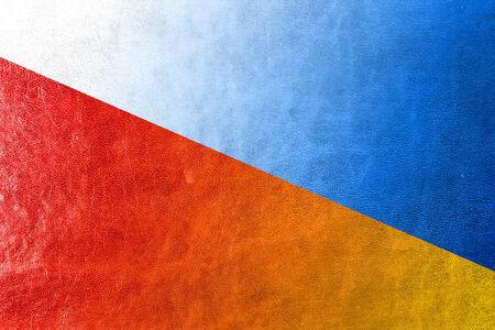 Poland and Ukraine Flag painted on leather texture photo