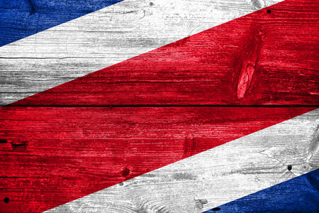 costa rica flag: Costa Rica Flag painted on old wood plank background Stock Photo