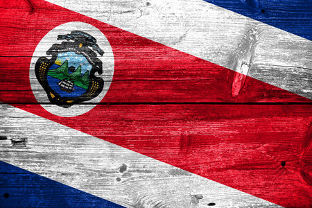 Costa Rica Flag painted on old wood plank background Stock Photo