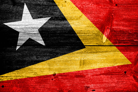 timor: East Timor Flag painted on old wood plank texture Stock Photo