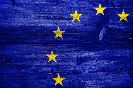 European Union Flag painted on old wood plank texture photo