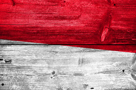 Indonesia Flag painted on old wood plank texture photo