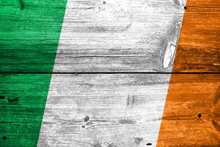 Ireland Flag painted on old wood plank background photo
