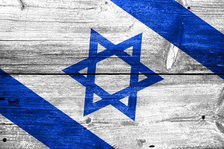 Israel flag painted on old wood plank background photo