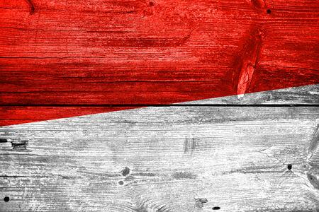 Monaco Flag painted on old wood plank texture photo