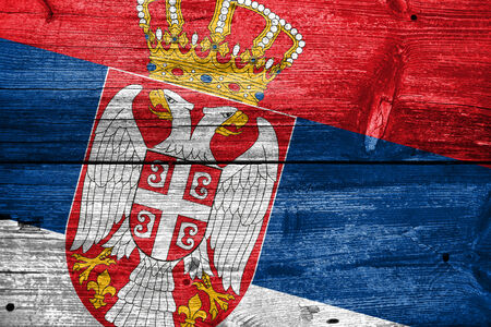 Serbia Flag painted on old wood plank texture photo