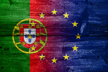 Portugal and European Union Flag painted on old wood plank texture photo