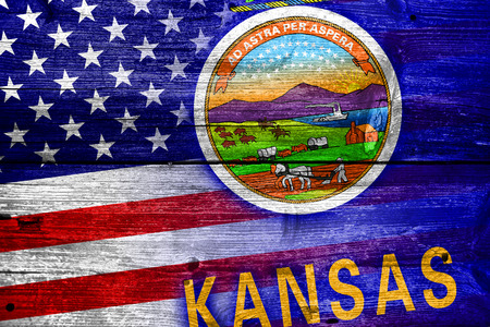 consolidated: USA and Kansas State Flag painted on old wood plank texture