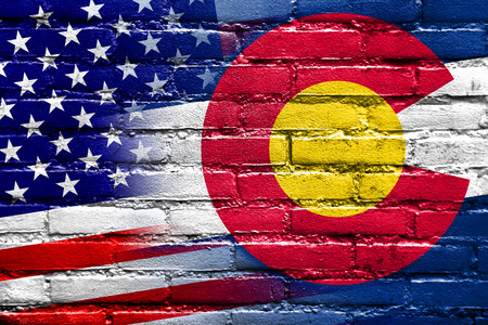 colorado state: USA and Colorado State Flag painted on brick wall Stock Photo