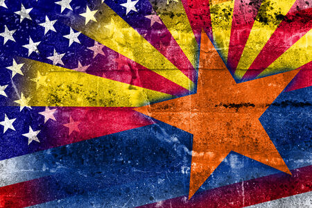 consolidated: USA and Arizona State Flag painted on grunge wall Stock Photo