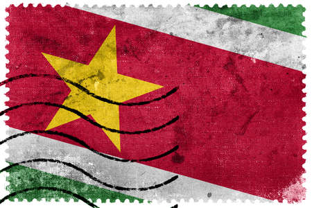 postage stamp: Suriname Flag - old postage stamp Stock Photo