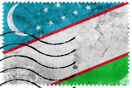 sello postal: Bandera de Uzbekist�n - antiguo sello postal Foto de archivo