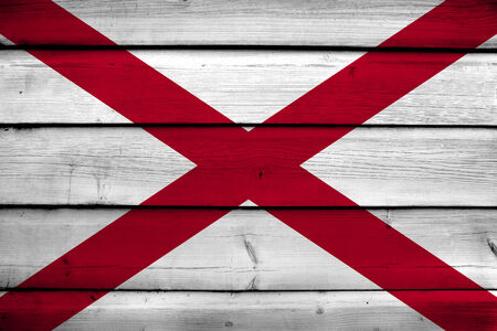 alabama flag: Alabama State Flag on wood background Stock Photo