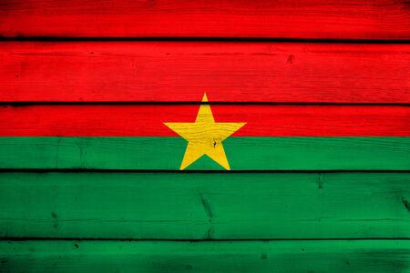 burkina faso: Burkina Faso Flag on wood background Stock Photo