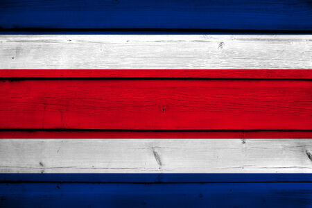 rican: Costa Rica Flag on wood background Stock Photo