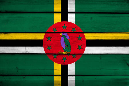 dominica: Dominica Flag on wood background
