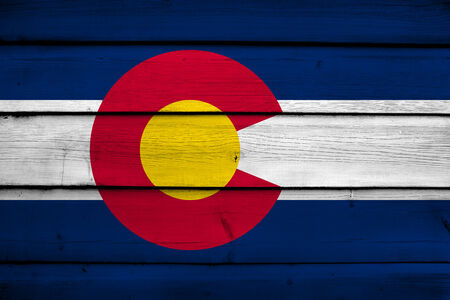 flag of colorado: Colorado State Flag on wood background Stock Photo