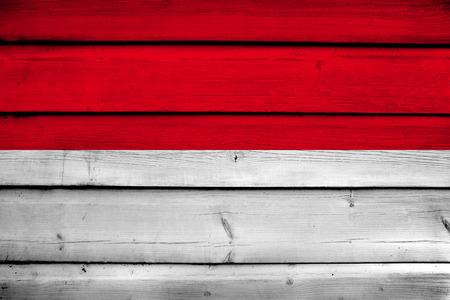 Indonesia Flag on wood background photo