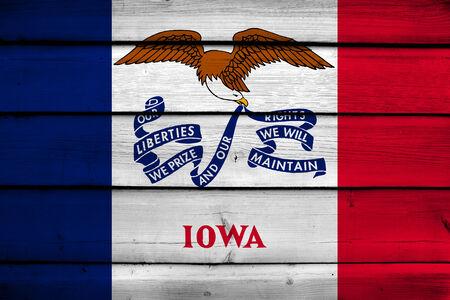 commonwealth: Iowa State Flag on wood background