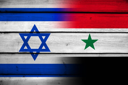 Israel and Syria Flag on wood background photo