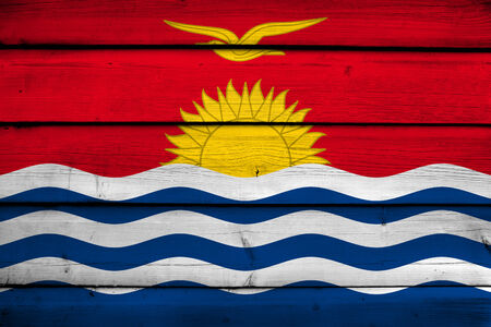 kiribati: Kiribati Flag on wood background Stock Photo