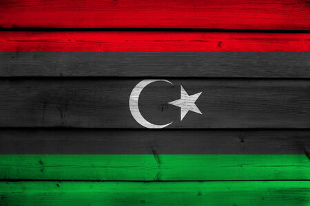 Libya Flag on wood background photo