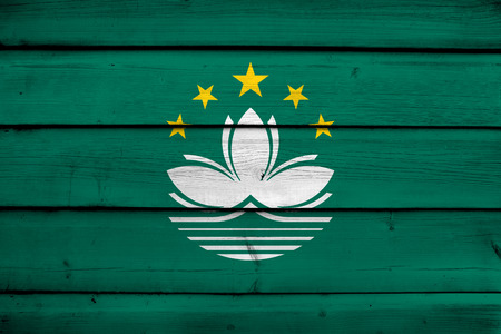 macau: Macau Flag on wood background