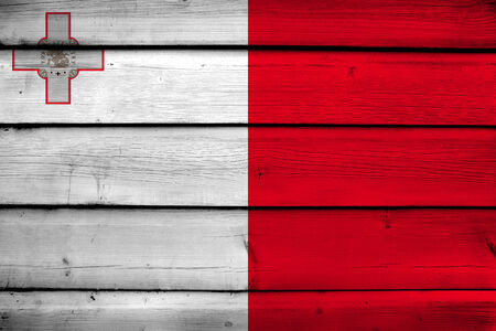 europe closeup: Malta Flag on wood background Stock Photo
