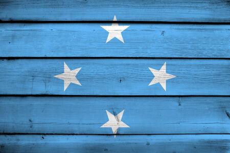 commonwealth: Micronesia Flag on wood background Stock Photo