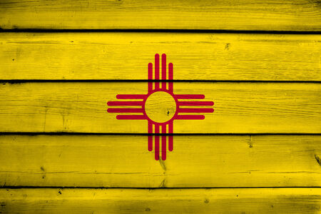 new mexico: New Mexico State Flag on wood background Stock Photo