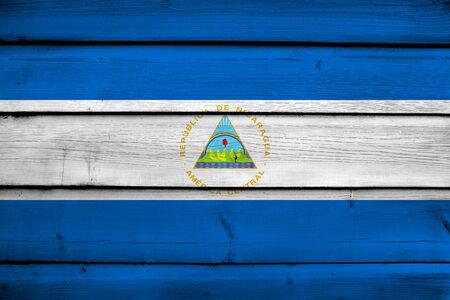 commonwealth: Nicaragua Flag on wood background