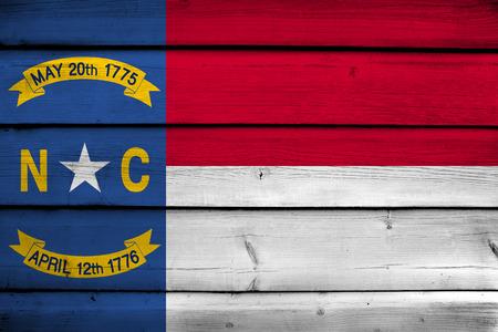 north carolina: North Carolina State Flag on wood background Stock Photo