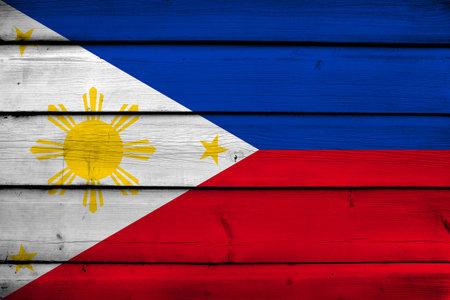 world flag: Philippines Flag on wood background