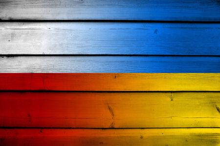Poland and Ukraine Flag on wood background photo
