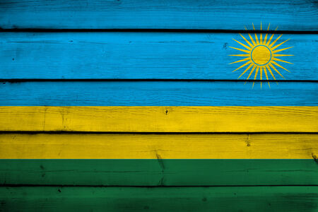 rwanda: Rwanda Flag on wood background