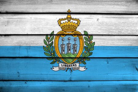 commonwealth: San Marino Flag on wood background