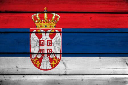 Serbia Flag on wood background photo