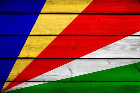 seychelles: Seychelles Flag on wood background