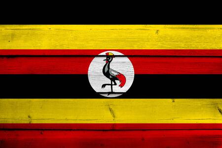 uganda: Uganda Flag on wood background
