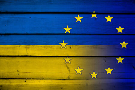 emblem of ukraine: Ukraine and EU Flag on wood background